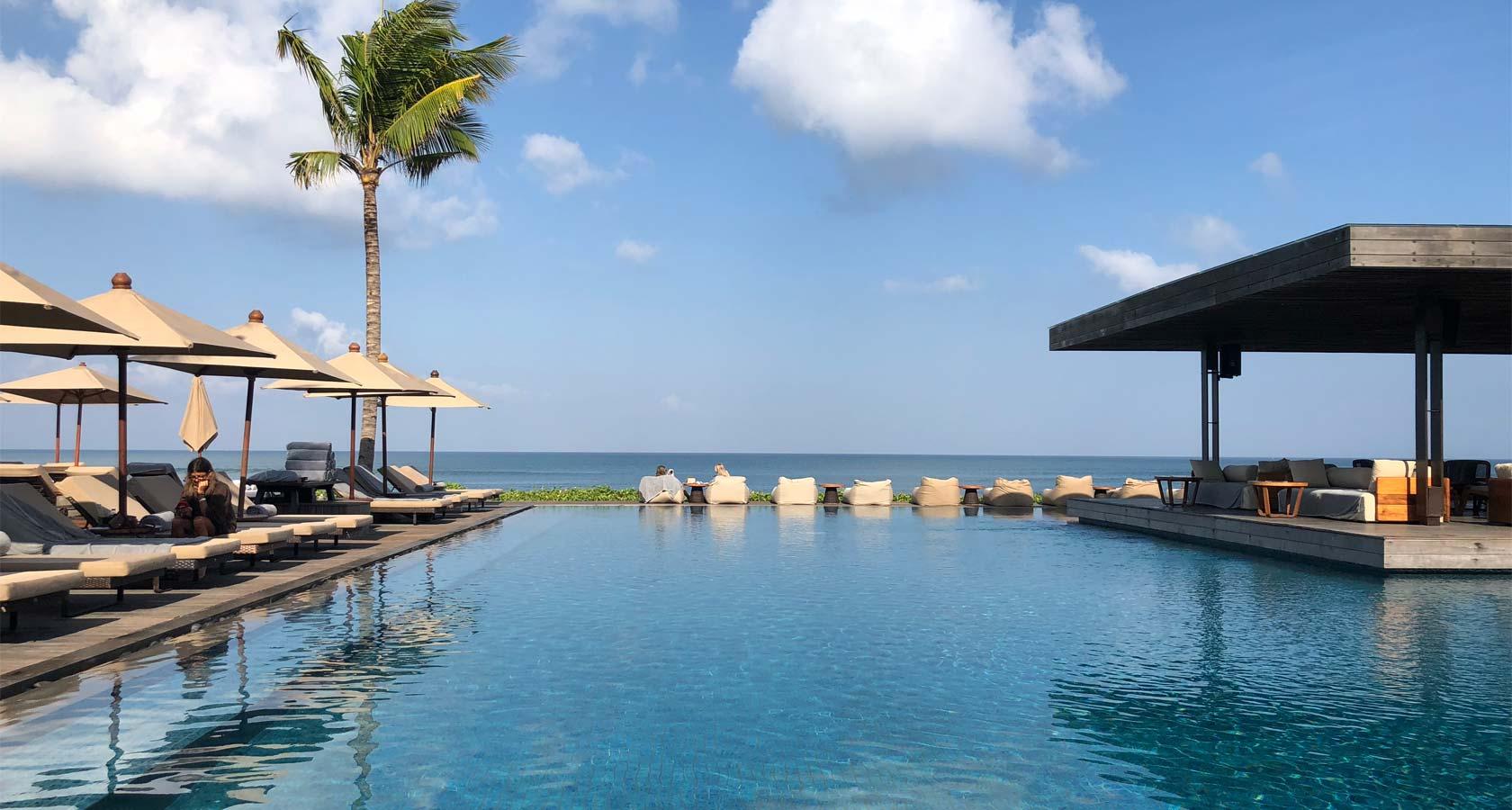 ALILA SEMINYAK Beach Bar pool blue water
