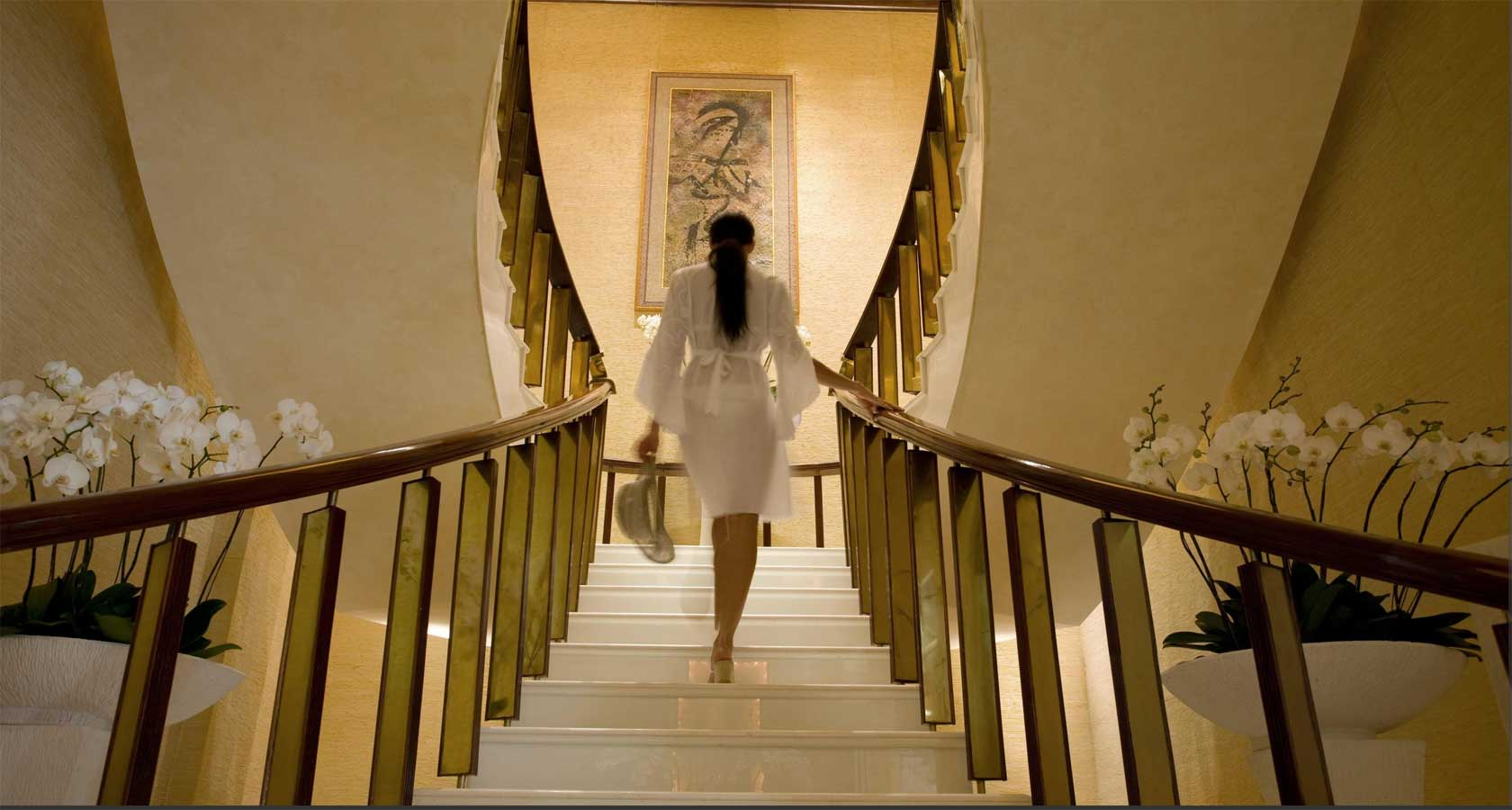 INTERCONTIENTAL BALI RESORT woman climbing stairs white gown