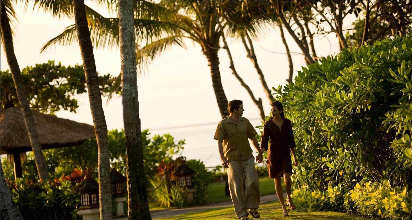INTERCONTINENTAL BALI RESORT couple walking in gardens